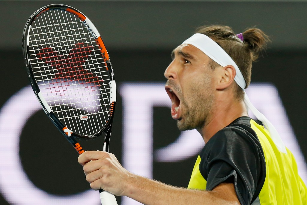 MELBOURNE, AUSTRALIA - JANUARY 18:  Marcos Baghdatis of Cyprus takes the second set in his first round match against  Jo-Wilfried Tsonga of France during day one of the 2016 Australian Open at Melbourne Park on January 18, 2016 in Melbourne, Australia.  (Photo by Darrian Traynor/Getty Images)