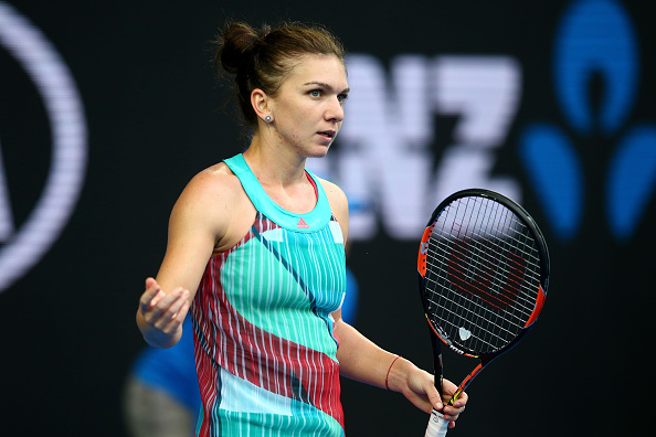 MELBOURNE, AUSTRALIA - JANUARY 19:  Simona Halep of Romania reacts in her first round match against Shuai Zhang of China during day two of the 2016 Australian Open at Melbourne Park on January 19, 2016 in Melbourne, Australia.  (Photo by Mark Kolbe/Getty Images)