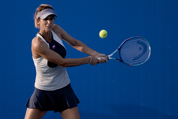 WUHAN, CHINA - SEPTEMBER 28:  (CHINA OUT) Tsvetana Pironkova of Bulgaria returns a shot against Camila Giorgi of Italy during day two of the 2015 Wuhan Open at Optics Vally International Tennis Center on September 28, 2015 in Wuhan, China.  (Photo by ChinaFotoPress/ChinaFotoPress via Getty Images)