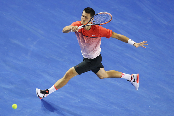 MELBOURNE, AUSTRALIA - JANUARY 25:  Bernard Tomic of Australia plays a forehand in his fourth round match against Andy Murray of Great Britain during day eight of the 2016 Australian Open at Melbourne Park on January 25, 2016 in Melbourne, Australia.  (Photo by Michael Dodge/Getty Images)