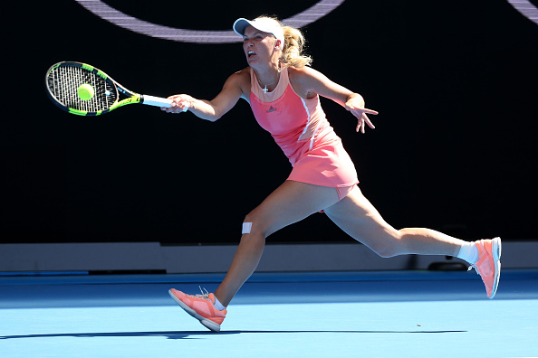 XXX of ZZZ plays a forehand in his/her first round match against XXXX of ZZZZ during day one of the 2016 Australian Open at Melbourne Park on January 18, 2016 in Melbourne, Australia.