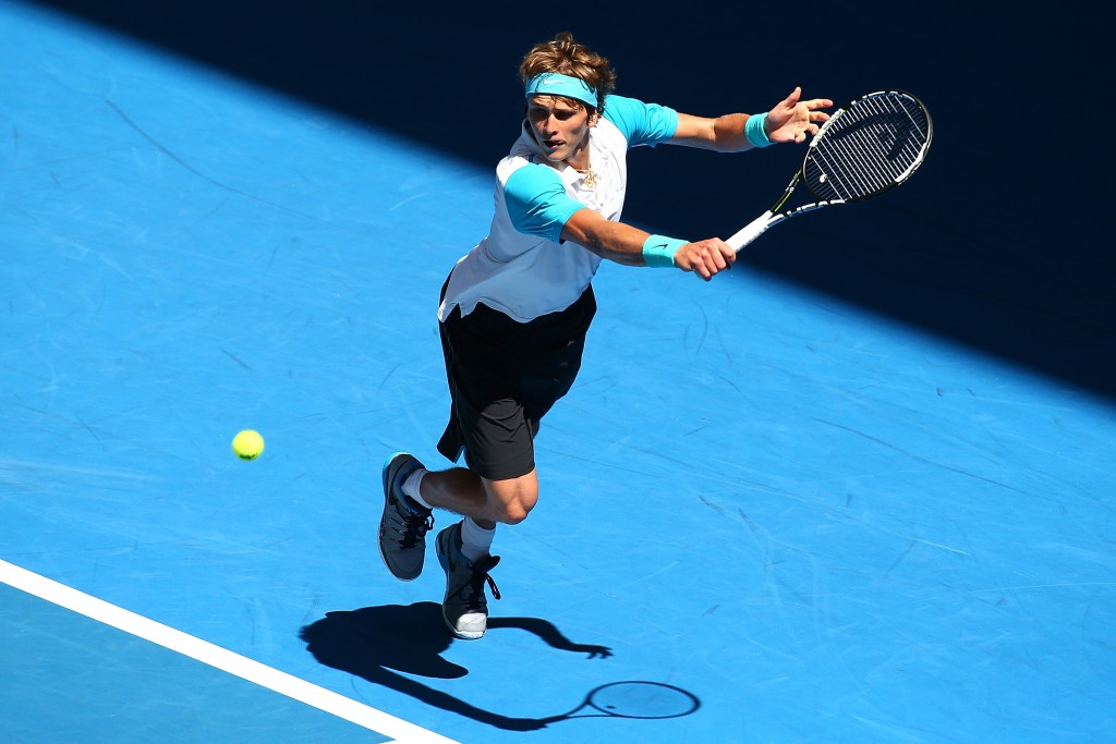 PERTH, AUSTRALIA - JANUARY 06:  Alexander Zverev of Germany plays a backhand in the mixed doubles match against Caroline Garcia and Kenny De Schepper of France during day four of the 2016 Hopman Cup at Perth Arena on January 6, 2016 in Perth, Australia.  (Photo by Paul Kane/Getty Images)