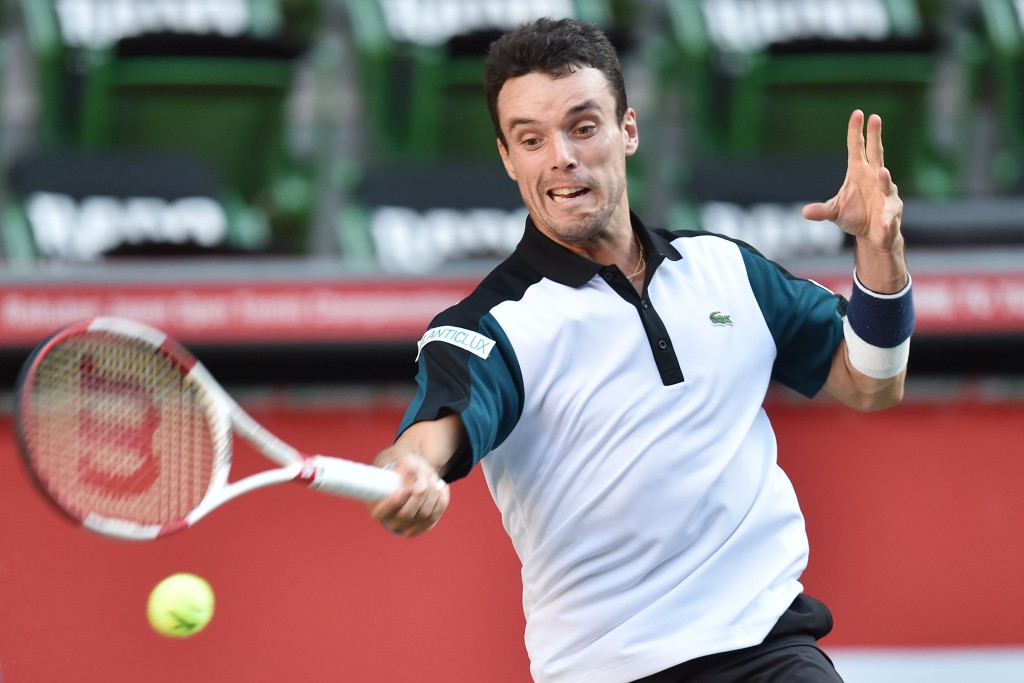 TOKYO, JAPAN - OCTOBER 08:  Roberto Bautista Agut of Spain returns a shot during the men's singles match against Nick Kyrgios of Australia on day four of Rakuten Open 2015 at Ariake Colosseum on October 8, 2015 in Tokyo, Japan.  (Photo by Atsushi Tomura/Getty Images)