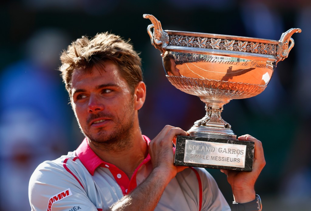 PARIS, FRANCE - JUNE 07:  Stanislas Wawrinka of Switzerland holds the Coupe de Mousquetaires after victory in the Men's Singles Final against Novak Djokovic of Serbia on day fifteen of the 2015 French Open at Roland Garros on June 7, 2015 in Paris, France.  (Photo by Julian Finney/Getty Images)