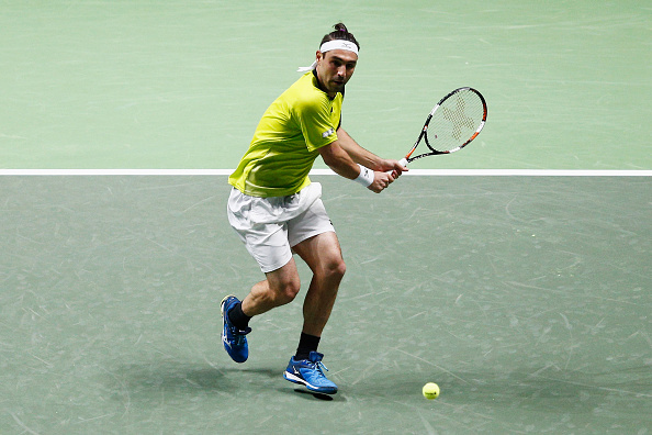 ROTTERDAM, NETHERLANDS - FEBRUARY 09:  Marcos Baghdatis of Cyprus in action against David Goffin of Belgium during day 2 of the ABN AMRO World Tennis Tournament held at Ahoy Rotterdam on February 9, 2016 in Rotterdam, Netherlands.  (Photo by Dean Mouhtaropoulos/Getty Images)
