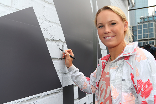 MELBOURNE, AUSTRALIA - JANUARY 14:  Caroline Wozniacki of Denmark signs her autograph during the adidas ACE Case Launch at Crown Entertainment Complex on January 14, 2016 in Melbourne, Australia.  (Photo by Graham Denholm/Getty Images for adidas)