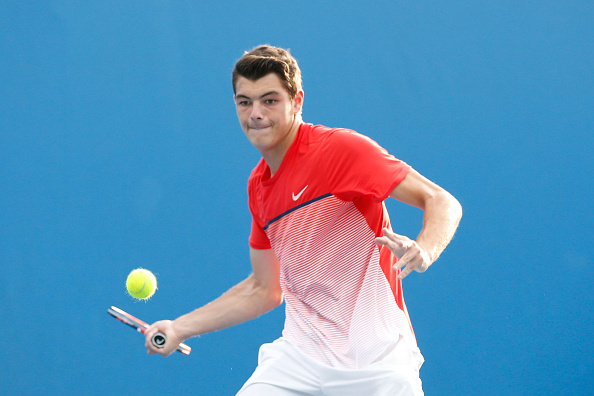 MELBOURNE, AUSTRALIA - JANUARY 19:  Taylor Fritz of the United States plays a forehand in his first round match against Jack Sock of the United States during day two of the 2016 Australian Open at Melbourne Park on January 19, 2016 in Melbourne, Australia.  (Photo by Darrian Traynor/Getty Images)