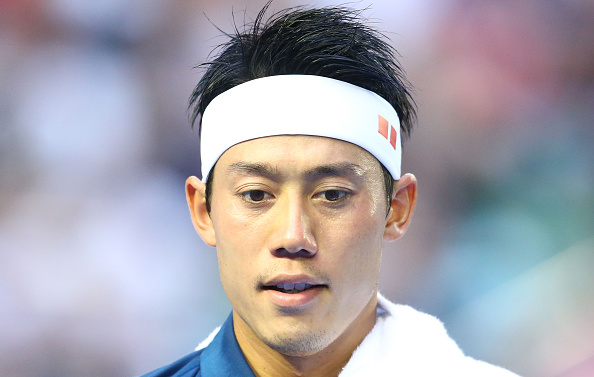 MELBOURNE, AUSTRALIA - JANUARY 26:  Kei Nishikori of Japan looks on in his quarter final match against Novak Djokovic of Serbia during day nine of the 2016 Australian Open at Melbourne Park on January 26, 2016 in Melbourne, Australia.  (Photo by Scott Barbour/Getty Images)