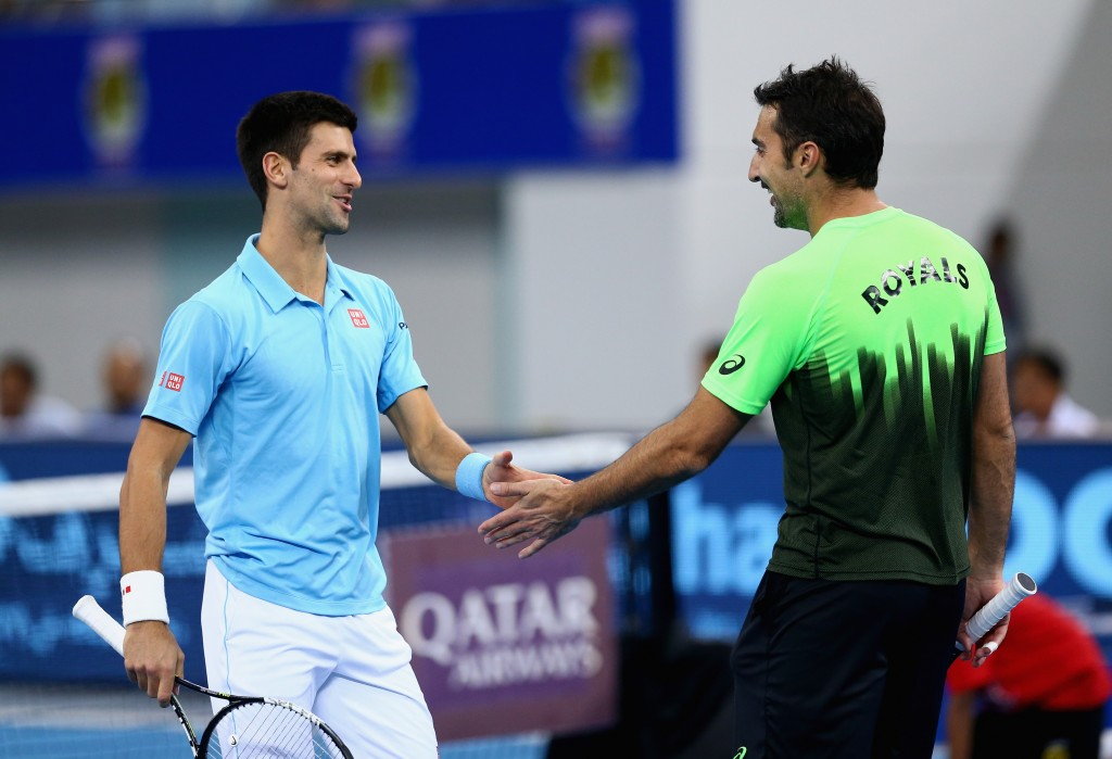 DUBAI, UNITED ARAB EMIRATES - DECEMBER 13:  Nenad Zimonjic and Novak Djokovic of the UAE Royals play against Rohan Bopanna and Gael Monfils of the Indian Aces during the Coca-Cola International Premier Tennis League fourth leg at the Hamdan Sports Complex, December 13, 2014 in Dubai.  (Photo by Clive Brunskill/Getty Images for IPTL 2014)