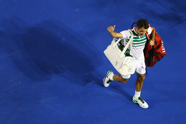 MELBOURNE, AUSTRALIA - JANUARY 28:  Roger Federer of Switzerland acknowledges the crowd after losing his semi final match against Novak Djokovic of Serbia during day 11 of the 2016 Australian Open at Melbourne Park on January 28, 2016 in Melbourne, Australia.  (Photo by Cameron Spencer/Getty Images)