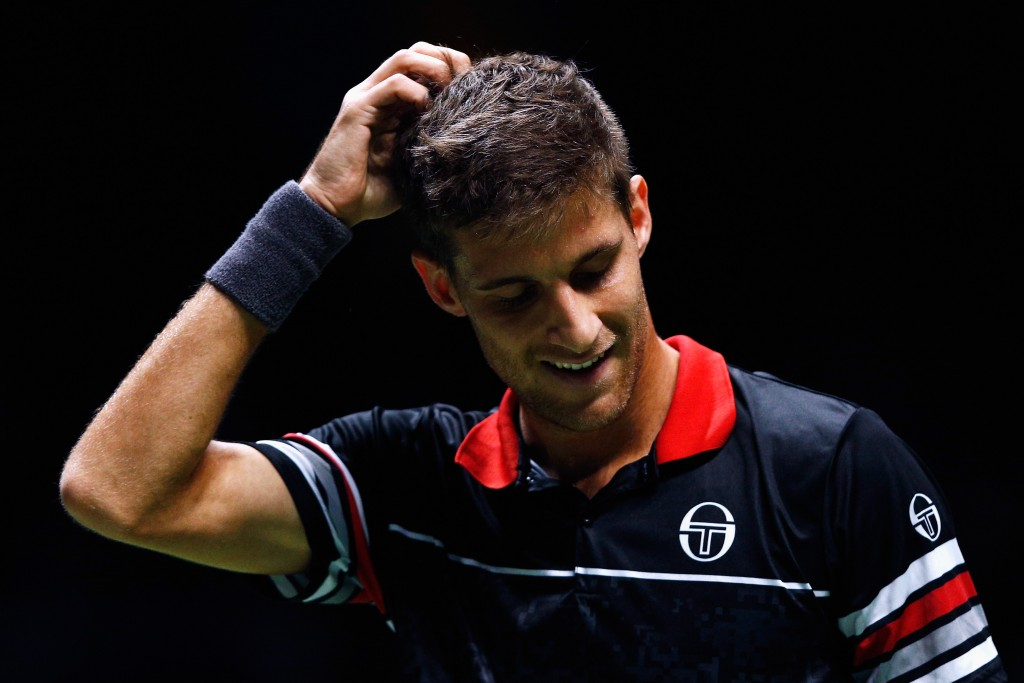 ROTTERDAM, NETHERLANDS - FEBRUARY 11:  Martin Klizan of Slovakia reacts to mssed point against Marcos Baghdatis of Cyprus during day 4 of the ABN AMRO World Tennis Tournament held at Ahoy Rotterdam on February 11, 2016 in Rotterdam, Netherlands.  (Photo by Dean Mouhtaropoulos/Getty Images)