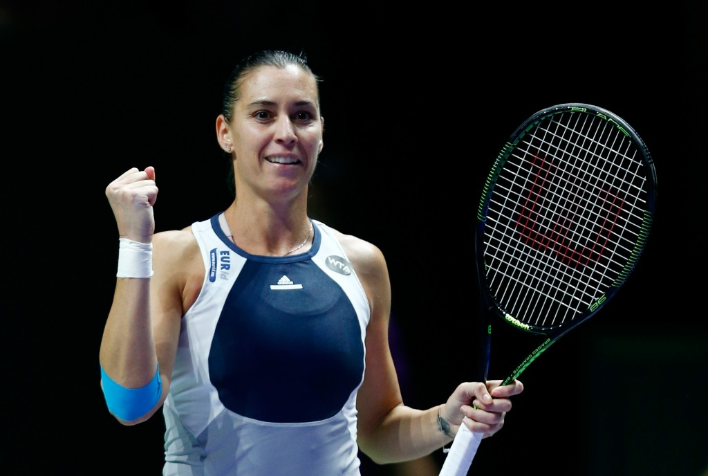 SINGAPORE - OCTOBER 27:  Flavia Pennetta of Italy celebrates match point against Agnieszka Radwanska of Poland in a round robin match during the BNP Paribas WTA Finals at Singapore Sports Hub on October 27, 2015 in Singapore.  (Photo by Julian Finney/Getty Images)