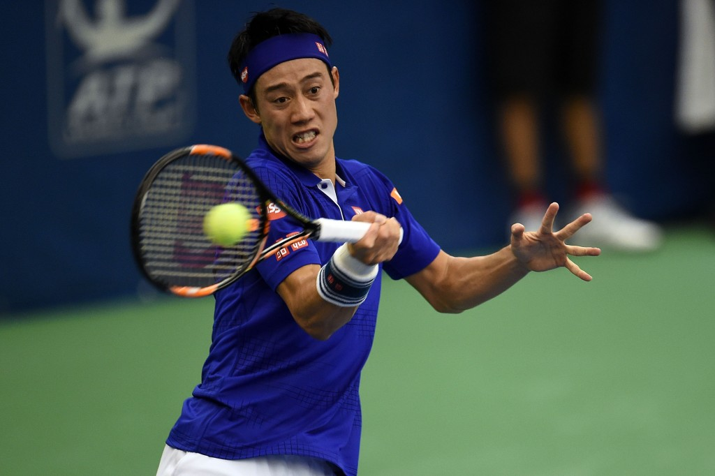 MEMPHIS, TN - FEBRUARY 12:  Kei Nishikori of Japan returns a shot to Mikhail Kukushkin of Kazakhstan during their quarterfinal singles match on Day 5 of the Memphis Open at the Racquet Club of Memphis on February 12, 2016 in Memphis, Tennessee.  (Photo by Stacy Revere/Getty Images)