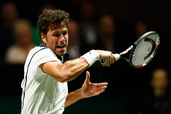 ROTTERDAM, NETHERLANDS - FEBRUARY 10:  Robin Haase of the Netherlands in action against Gilles Simon of France  during day 3 of the ABN AMRO World Tennis Tournament held at Ahoy Rotterdam on February 10, 2016 in Rotterdam, Netherlands.  (Photo by Dean Mouhtaropoulos/Getty Images)