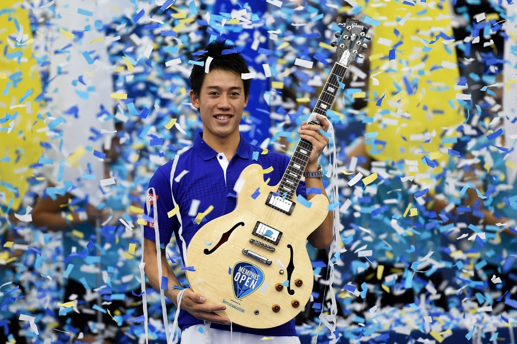 MEMPHIS, TN - FEBRUARY 14:  Kei Nishikori of Japan celebrates with the trophy after defeating Taylor Fritz of the United States in their singles final match on Day 7 of the Memphis Openat the Racquet Club of Memphis on February 14, 2016 in Memphis, Tennessee.  (Photo by Stacy Revere/Getty Images)