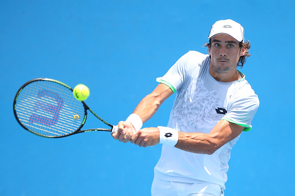 MELBOURNE, AUSTRALIA - JANUARY 19:  Guido Pella of Argentina plays a backhand in his first round match against Steve Darcis of Belgium during day two of the 2016 Australian Open at Melbourne Park on January 19, 2016 in Melbourne, Australia.  (Photo by Quinn Rooney/Getty Images)