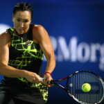 DUBAI, UNITED ARAB EMIRATES - FEBRUARY 16:  Jelena Jankovic of Serbia plays a backhand in her match against  Belinda Bencic of Switzerland during day two of the WTA Dubai Duty Free Tennis Championship at the Dubai Duty Free Stadium on February 16, 2016 in Dubai, United Arab Emirates.  (Photo by Francois Nel/Getty Images)