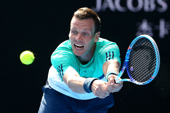 MELBOURNE, AUSTRALIA - JANUARY 26:  Tomas Berdych of the Czech Republic plays a backhand in his quarter final match against Roger Federer of Switzerland during day nine of the 2016 Australian Open at Melbourne Park on January 26, 2016 in Melbourne, Australia.  (Photo by Scott Barbour/Getty Images)