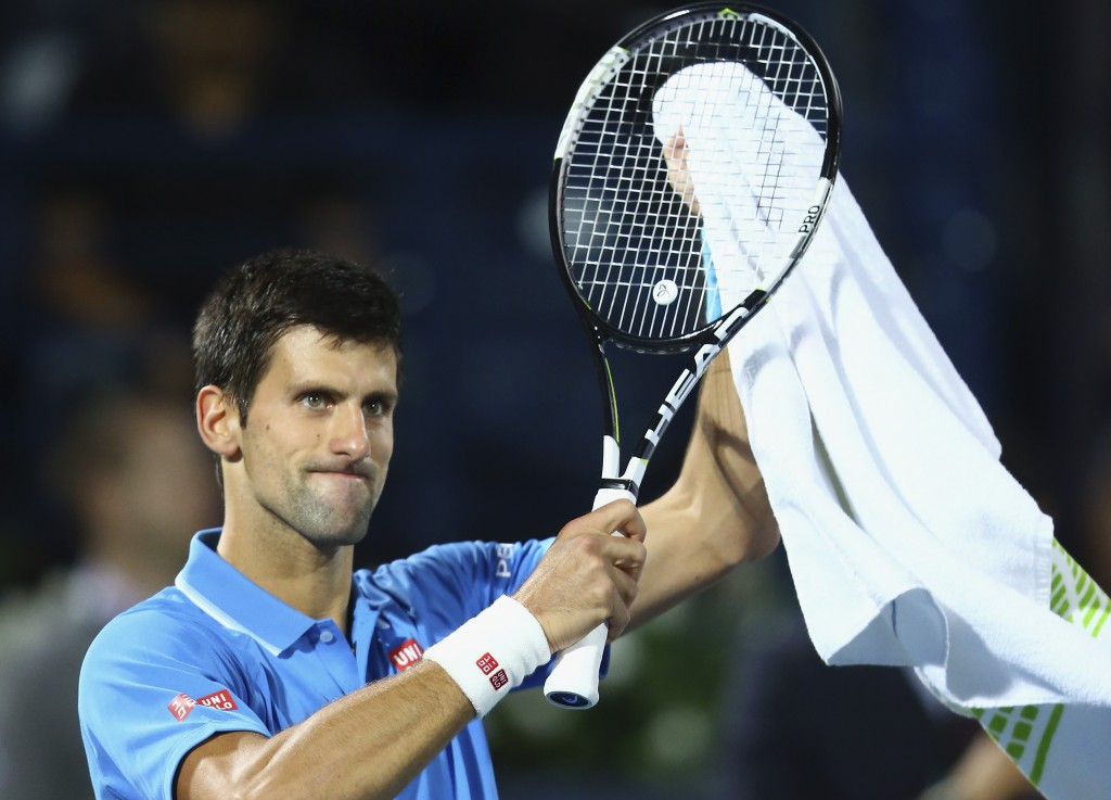 during their men's singles quarterfinal match of the ATP Dubai Duty Free Tennis Championships at the Dubai Duty Free Stadium on February 26, 2015 in Dubai, United Arab Emirates.
