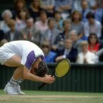 Jun 1992:  John McEnroe of the USA curls into a ball during his match against Andre Agassi also of the USA at the Lawn Tennis Championships at Wimbledon in London.   Mandatory Credit: Bob  Martin/Allsport