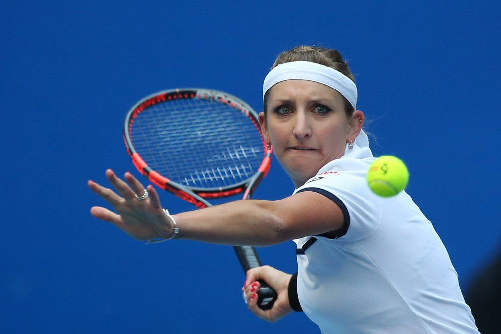BEIJING, CHINA - OCTOBER 10:  Timea  Bacsinszky of Switzerland returns a ball against Ana Ivanovic of Serbia during the Women's single semi-final match on day 8 of the 2015 China Open at the China National Tennis Center on October 10, 2015 in Beijing, China.  (Photo by Emmanuel Wong/Getty Images)