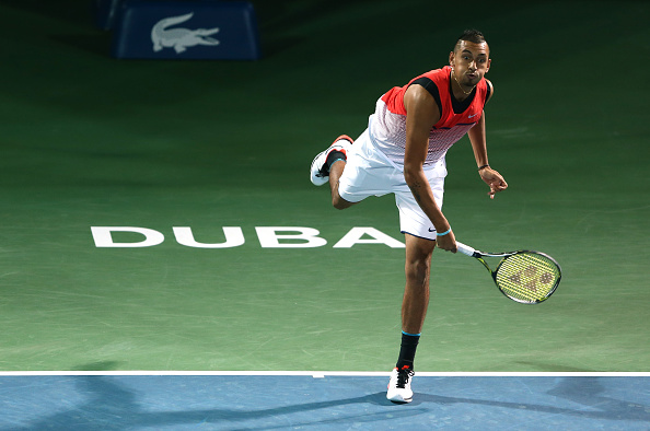 in action against  during day four of the ATP Dubai Duty Free Tennis Championship at the Dubai Duty Free Stadium on February 23, 2016 in Dubai, United Arab Emirates.