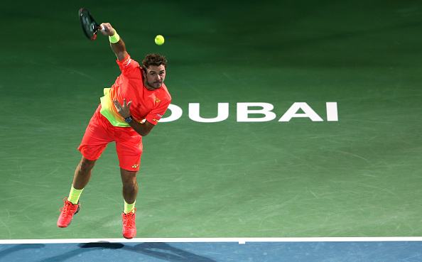 in action against  during day five of the ATP Dubai Duty Free Tennis Championship at the Dubai Duty Free Stadium on February 24, 2016 in Dubai, United Arab Emirates.