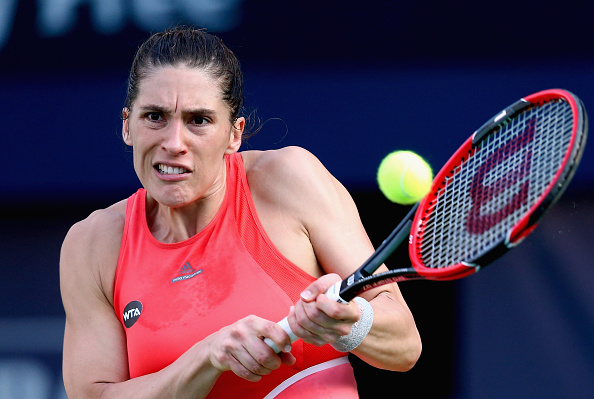 DUBAI, UNITED ARAB EMIRATES - FEBRUARY 15:  Andrea Petkovic plays a backhand  in her match against  Camila Giorgi of Italy during day one of the WTA Dubai Duty Free Tennis Championship at the Dubai Duty Free Stadium on February 15, 2016 in Dubai, United Arab Emirates.  (Photo by Francois Nel/Getty Images)