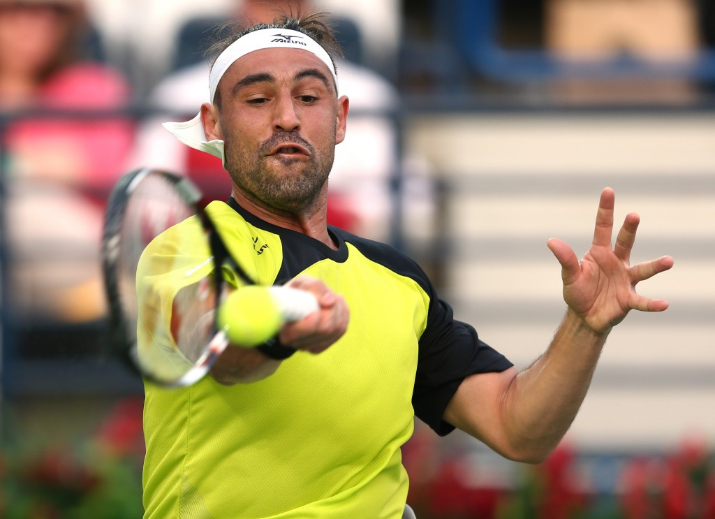 DUBAI, UNITED ARAB EMIRATES - FEBRUARY 25:  Marcos Baghdatis of Cyprus in action during his quarter final match against Roberto Bautisra Agut of Spain on day six of the ATP Dubai Duty Free Tennis Championship at the Dubai Duty Free Stadium on February 25, 2016 in Dubai, United Arab Emirates.  (Photo by Warren Little/Getty Images)