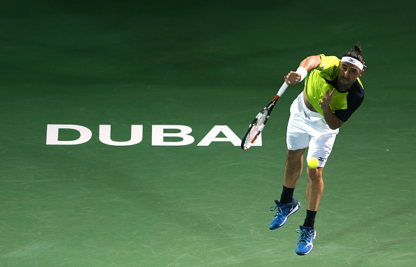 DUBAI, UNITED ARAB EMIRATES - FEBRUARY 26:  Marcos Baghdatis of Cyrus in action during his semi final match against Feliciano Lopez of Spain on day seven of the ATP Dubai Duty Free Tennis Championship at the Dubai Duty Free Stadium on February 26, 2016 in Dubai, United Arab Emirates.  (Photo by Warren Little/Getty Images)