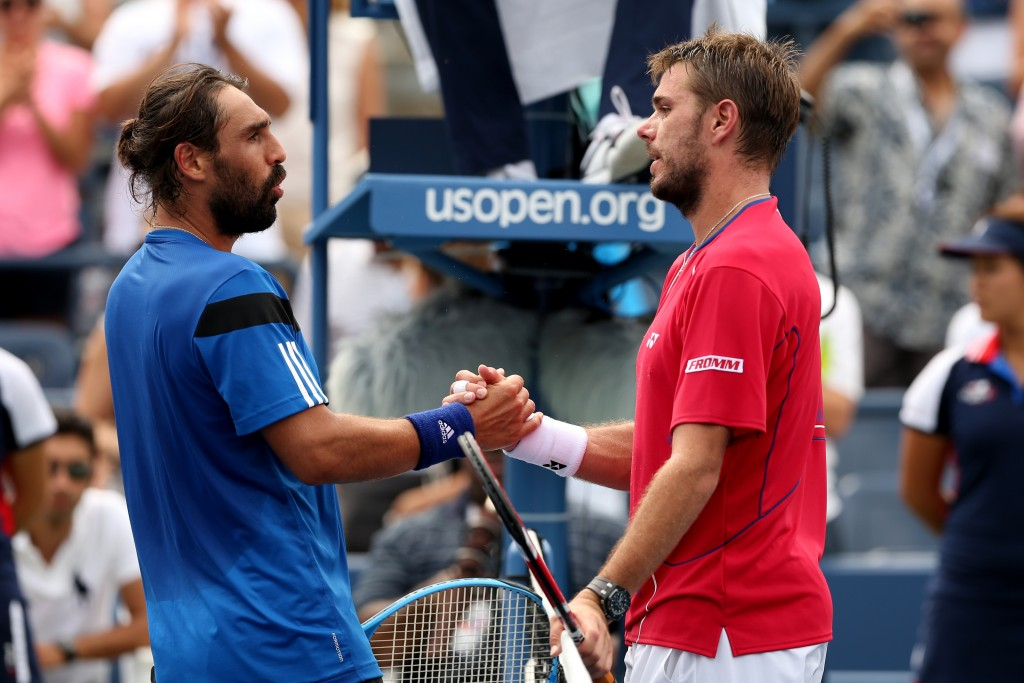 NEW YORK, NY - SEPTEMBER 01:  Stanislas Wawrinka (R) of Switzerland shakes hands with Marcos Baghdatis (L) of Cyprus after winning his men's singles third round match on Day Seven of the 2013 US Open at USTA Billie Jean King National Tennis Center on September 1, 2013 in the Flushing neighborhood of the Queens borough of New York City.  (Photo by Matthew Stockman/Getty Images)