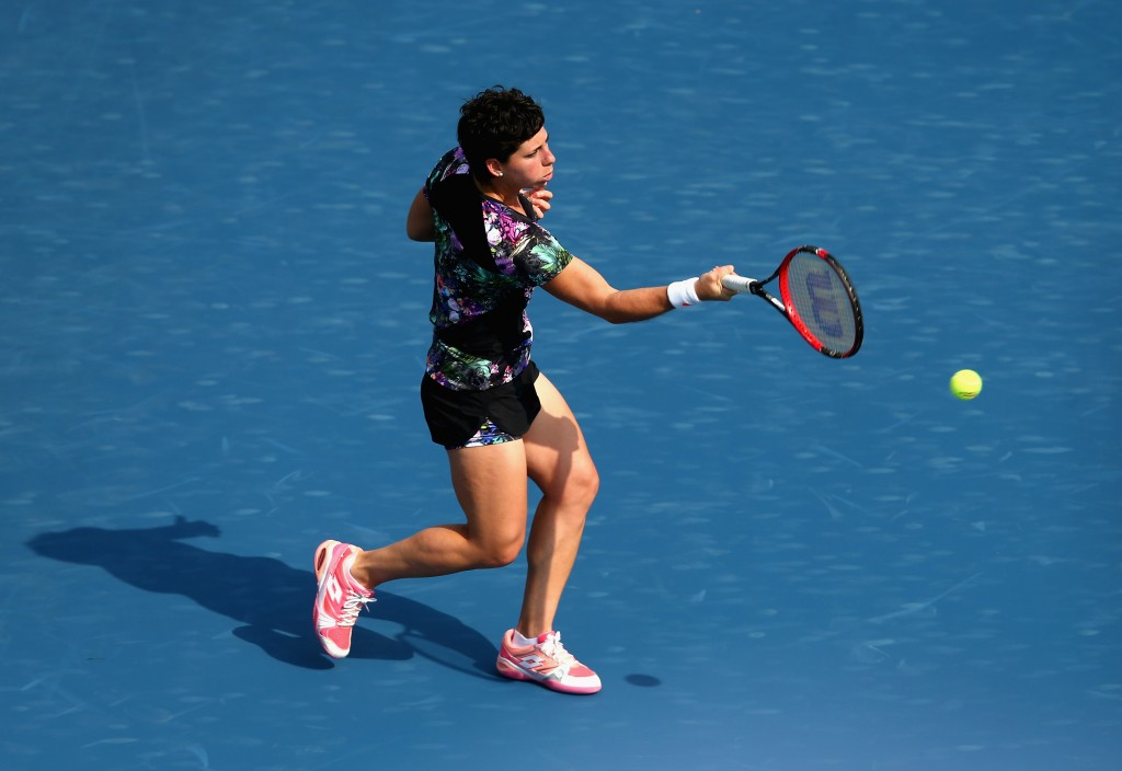 DUBAI, UNITED ARAB EMIRATES - FEBRUARY 17:  Carla Suarez Navarro of Spain in action in her match against Caroline Garcia of France during day three of the WTA Dubai Duty Free Tennis Championship at the Dubai Duty Free Stadium  on February 17, 2016 in Dubai, United Arab Emirates.  (Photo by Francois Nel/Getty Images)