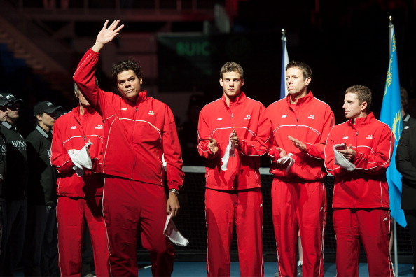 VANCOUVER, CANADA - APRIL 5:  Milos Raonic of Canada is introduced before the Davis Cup Quarterfinals between Canada and Italy on day one of the 2013 Davis Cup quarterfinals on April 5, 2013 at Doug Mitchell Thunderbird Sports Centre in Vancouver, British Columbia, Canada.  (Photo by Derek Leung/Getty Images)