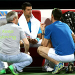 DUBAI, UNITED ARAB EMIRATES - FEBRUARY 25:  Novak Djokovic of Serbia receives medical attention on court during his quarter final match against Feliciano Lopez of Spain on day six of the ATP Dubai Duty Free Tennis Championship at the Dubai Duty Free Stadium on February 25, 2016 in Dubai, United Arab Emirates.  (Photo by Warren Little/Getty Images)