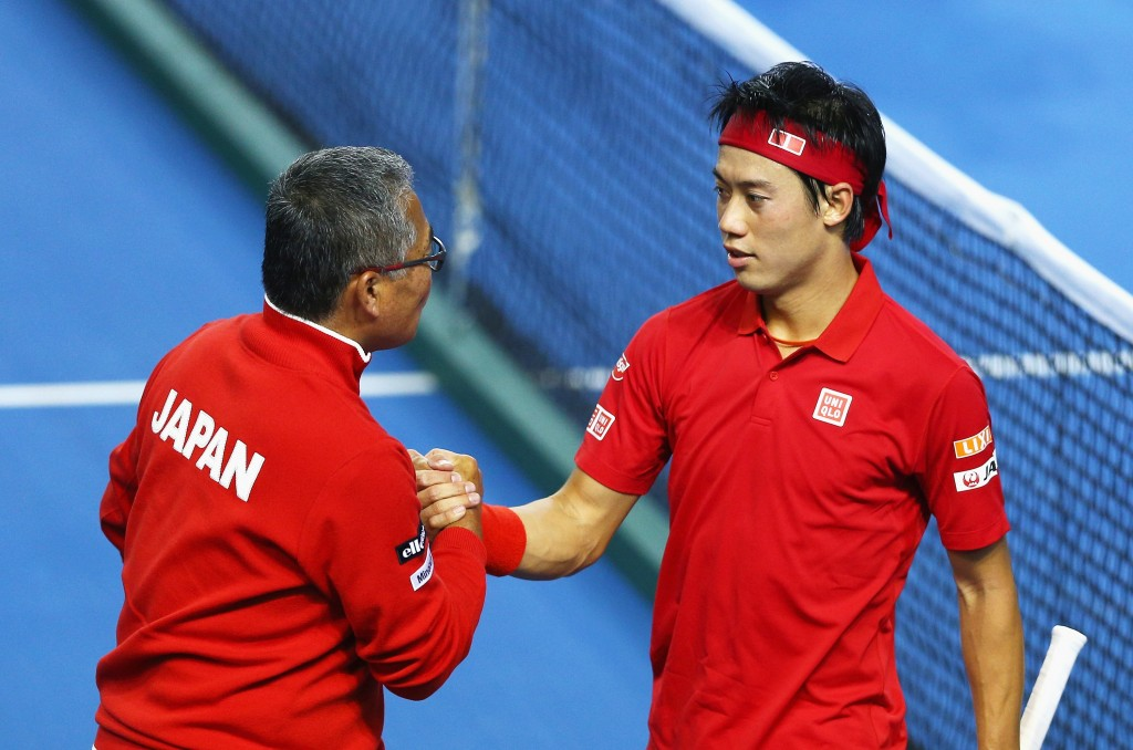 BIRMINGHAM, ENGLAND - MARCH 04:  Kei Nishikori of Japan shakes hands with captain Minoru Ueda after he defeated Daniel Evans of Great Britain in his singles match during day one of the Davis Cup World Group first round tie between Great Britain and Japan at Barclaycard Arena on March 4, 2016 in Birmingham, England.  (Photo by Clive Brunskill/Getty Images)
