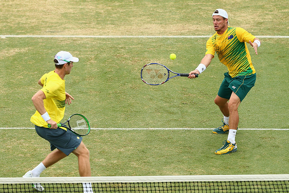 MELBOURNE, AUSTRALIA - MARCH 05:  John Peers of Australia and Lleyton Hewitt of Australia in action in Men's doubles match against Mike Bryan and Bob Bryan of the United States during the Davis Cup tie between Australia and the United States at Kooyong on March 5, 2016 in Melbourne, Australia.  (Photo by Robert Prezioso/Getty Images)