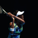 MELBOURNE, AUSTRALIA - JANUARY 19:  Venus Williams of the United States plays a backhand in her first round match against Johanna Konta of Great Britain  during day two of the 2016 Australian Open at Melbourne Park on January 19, 2016 in Melbourne, Australia.  (Photo by Ryan Pierse/Getty Images)