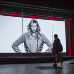 A shopper walks past a Nike Inc. advertisement featuring tennis player Maria Sharapova in Shanghai, China, on Monday, Dec. 21, 2015. China will add monetary stimulus next year, making good on a pledge to support growth as leaders push through policies to cut overcapacity and reliance on credit, according to economists surveyed by Bloomberg. Photographer: Qilai Shen/Bloomberg via Getty Images