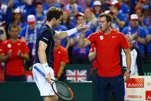 BIRMINGHAM, ENGLAND - MARCH 06:  Andy Murray of Great Britain celebrates with Leon Smith the Great Britain team captain during the singles match against Kei Nishikori of Japan on day three of the Davis Cup World Group first round tie at the Barclaycard Arena on March 6, 2016 in Birmingham, England.  (Photo by Jordan Mansfield/Getty Images for LTA)