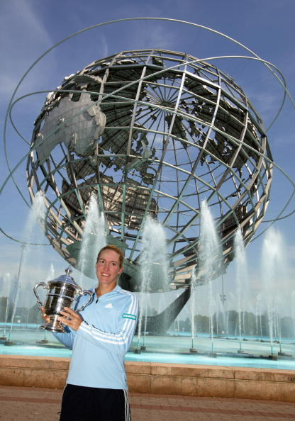 FLUSHING, NY - SEPTEMBER 7:  Singles champion Justine Henin-Hardenne of Belgium holds the trophy in front of the Unisphere during the US Open at the USTA National Tennis Center in Flushing Meadows Corona Park on September 7, 2003 in Flushing, New York.  (Photo by Al Bello/Getty Images)