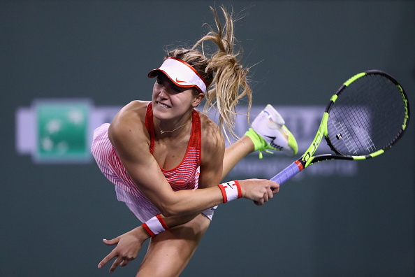INDIAN WELLS, CA - MARCH 10:  Eugenie Bouchard of Canada serves to Risa Ozaki of Japan during day four of the BNP Paribas Open at Indian Wells Tennis Garden on March 10, 2016 in Indian Wells, California.  (Photo by Julian Finney/Getty Images)
