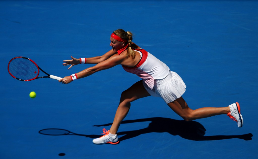 MELBOURNE, AUSTRALIA - JANUARY 18:  Petra Kvitova of the Czech Republic plays a backhand a point in her first round match against Luksika Kumkhum of Thailand during day one of the 2016 Australian Open at Melbourne Park on January 18, 2016 in Melbourne, Australia.  (Photo by Cameron Spencer/Getty Images)