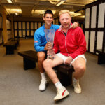 KEY BISCAYNE, FL - APRIL 05:  Novak Djokovic of Serbia poses for a locker room photograph with his coach Boris Becker and the Butch Bucholz trophy after his three set victory against Andy Murray of Great Britain in the mens final during the Miami Open Presented by Itau at Crandon Park Tennis Center on April 5, 2015 in Key Biscayne, Florida.  (Photo by Clive Brunskill/Getty Images)