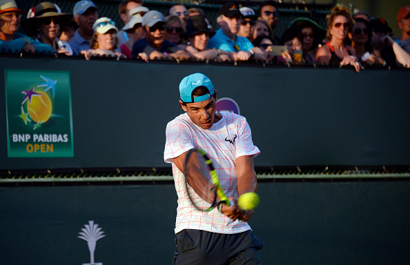 INDIAN WELLS, CA - MARCH 10: Rafael Nadal of Spain practices in front of a large crowd during day four of the BNP Paribas Open at Indian Wells Tennis Garden on March 10, 2016 in Indian Wells, California. (Photo by Kevork Djansezian/Getty Images)