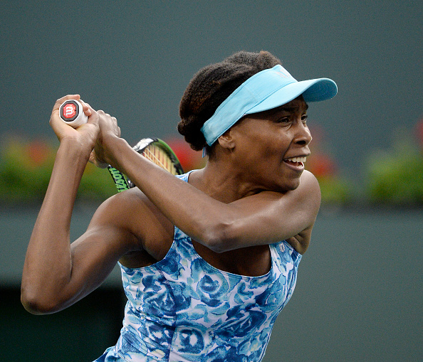 INDIAN WELLS, CA - MARCH 11: Venus Williams of the United States hits a backhand against Kurumi Nara of Japan during day five of the BNP Paribas Open at Indian Wells Tennis Garden on March 11, 2016 in Indian Wells, California. Williams made her first appearance on court after a 15 year absence from the event. (Photo by Kevork Djansezian/Getty Images)