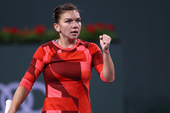 INDIAN WELLS, CA - MARCH 11:  Simona Halep of Romania celebrates winning a game against Vania King of USA during day five of the BNP Paribas Open at Indian Wells Tennis Garden on March 11, 2016 in Indian Wells, California.  (Photo by Julian Finney/Getty Images)