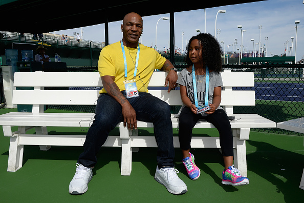 INDIAN WELLS, CA - MARCH 13:  Mike Tyson and daughter Milan Tyson sit on the practice courts during day seven of the BNP Paribas Open at Indian Wells Tennis Garden on March 13, 2016 in Indian Wells, California.  (Photo by Kevork Djansezian/Getty Images)