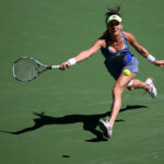 INDIAN WELLS, CA - MARCH 13:  Agnieszka Radwanska of Poland returns a shot by Monica Niculescu of Romania during the BNP Paribas Open at the Indian Wells Tennis Garden on March 11 at  Indian Wells Tennis Garden on March 12, 2016 in Indian Wells, California  (Photo by Sean M. Haffey/Getty Images)