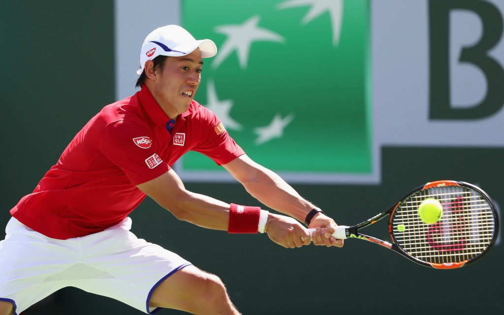 INDIAN WELLS, CA - MARCH 15:  Kei Nishikori of Japan in action against Steve Johnson of USA during day nine of the BNP Paribas Open at Indian Wells Tennis Garden on March 15, 2016 in Indian Wells, California.  (Photo by Julian Finney/Getty Images)