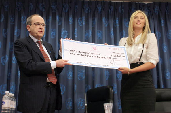 Ad Melkert, Associate Adminsistrator of the UNDP receives a check from  Maria Sharapova during the press conference in which she is appointed UNDP Goodwill Ambassador at the United Nations on February 14, 2007.  Maria used the occasion to donate $100,000 to eight Chernobyl recovery projects in Belarus, the Russian Federation and Ukraine (Photo by Jemal Countess/WireImage)